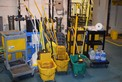 LOT OF JANITORIAL EQUIPMENT - BROOMS, MOP BUCKETS, MOPS, CLEANERS, ROLLING CARTS