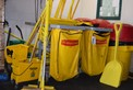 LOT OF JANITORIAL EQUIPMENT - BROOMS, GARBAGE BIN, MOP BUCKET