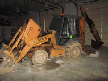 Case 580L Backhoe With Extend A Hoe And Cab And Four-Wheel-Drive