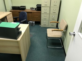 Office with Desk, Chair,  and Shelf. No File Cabinets or Electronics