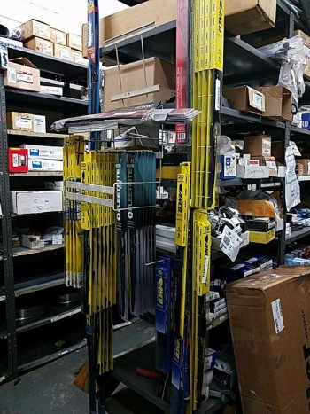 Run of four industrial shelving units and