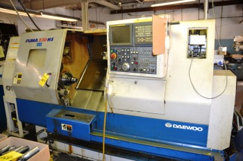 2001 Daewoo CNC Lathe with Space Saver 2100 S/N 23MSQ178 Model Puma 230 MS
