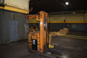 2,300 lb Clark Electric Stand up Fork lift
