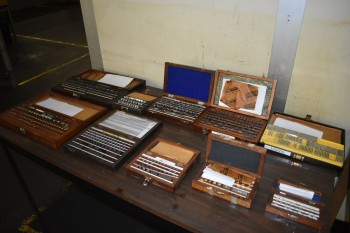 Lot of various sized Precision Gage block sets,Formica top table