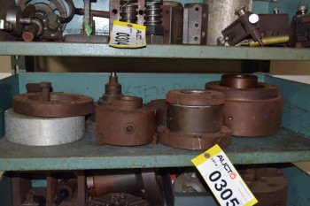 SHELF OF ASSORTED MACHINE PARTS