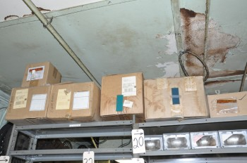 Lot-Empty Cutter Boxes and Packaging on Top Shelf