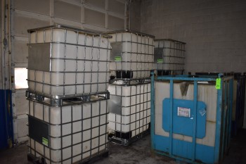 Lot of (8) Plasctic IBC Totes w/ Metal Cage Protectors