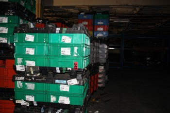 38 pallets of plastic storage bins